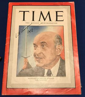 photo of TIME magazine cover with red border and older man in black suit